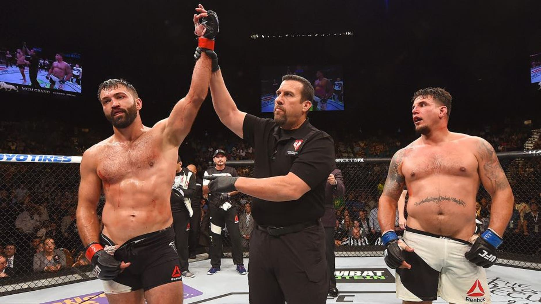 LAS VEGAS, NV - SEPTEMBER 05: Andrei Arlovski (left) reacts to his victory over Frank Mir (right) in their heavyweight bout during the UFC 191 event inside MGM Grand Garden Arena on September 5, 2015 in Las Vegas, Nevada. (Photo by Josh Hedges/Zuffa LLC/Zuffa LLC via Getty Images)