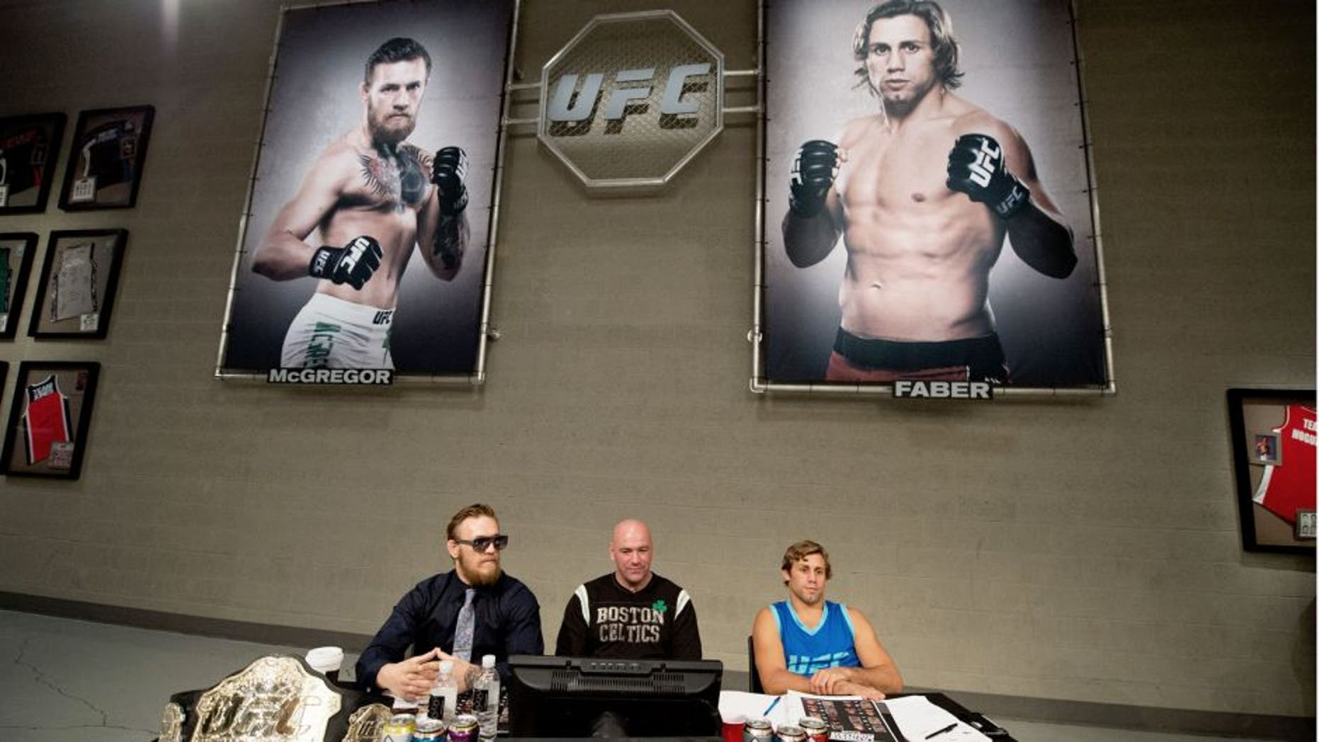 LAS VEGAS, NV - JULY 17: (L-R) Conor McGregor, UFC president Dana White, and Urijah Faber watch the elimination fights at the UFC TUF Gym on July 17, 2015 in Las Vegas, Nevada. (Photo by Brandon Magnus/Zuffa LLC/Zuffa LLC via Getty Images)