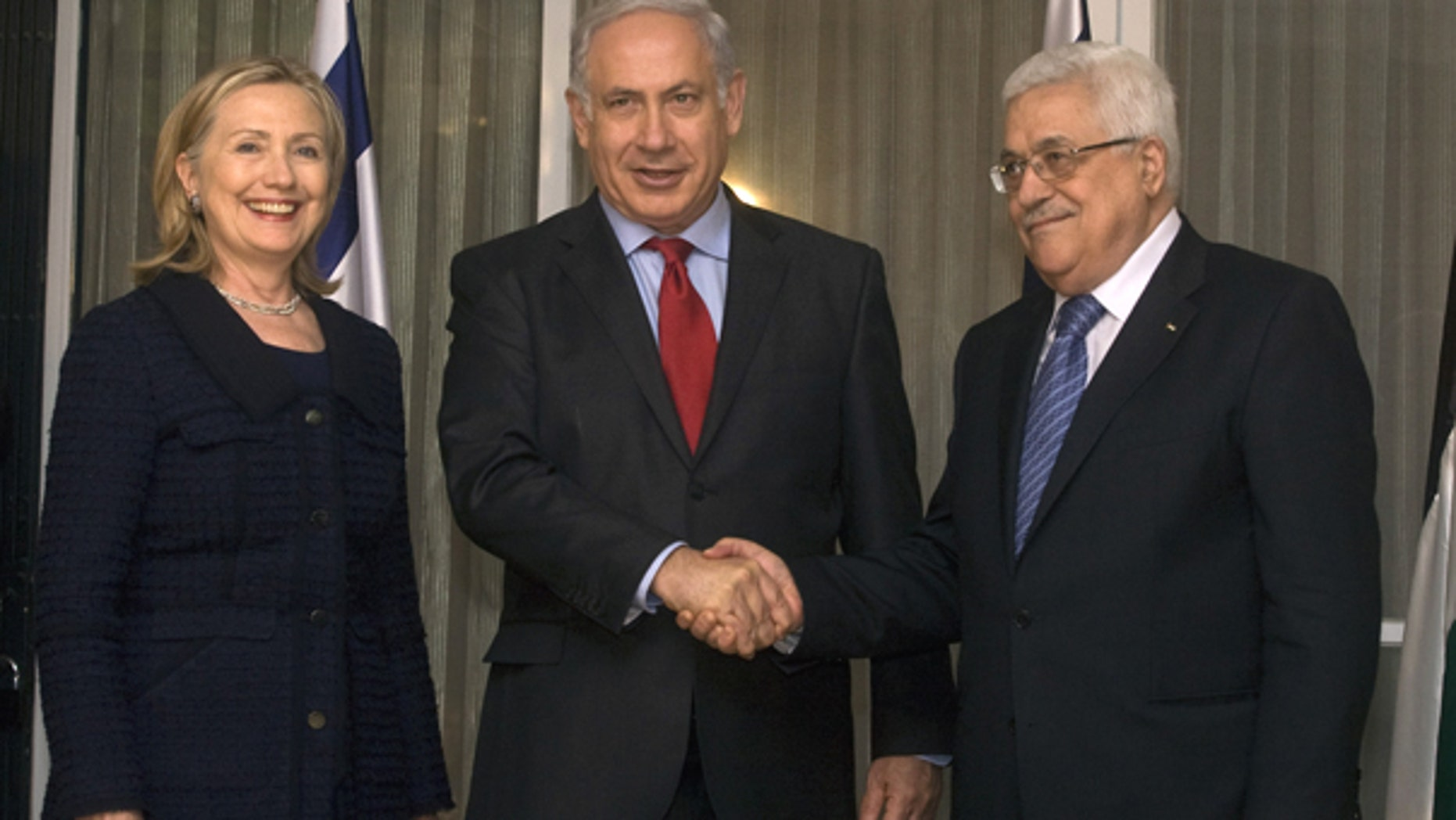 Sept. 15: Israeli Prime Minister Benjamin Netanyahu, center, shakes hands with Palestinian President Mahmoud Abbas, right, as Secretary of State Hillary Rodham Clinton smiles during a meeting at the Prime Ministers' residence in Jerusalem, Israel.