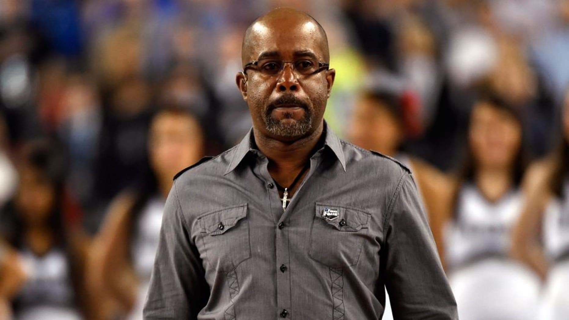 Apr 7, 2014; Arlington, TX, USA; Recording artist Darius Rucker comes out to sing the national anthem before the championship game of the Final Four in the 2014 NCAA Mens Division I Championship tournament between the Connecticut Huskies and Kentucky Wildcats at AT&T Stadium. Mandatory Credit: Robert Deutsch-USA TODAY Sports