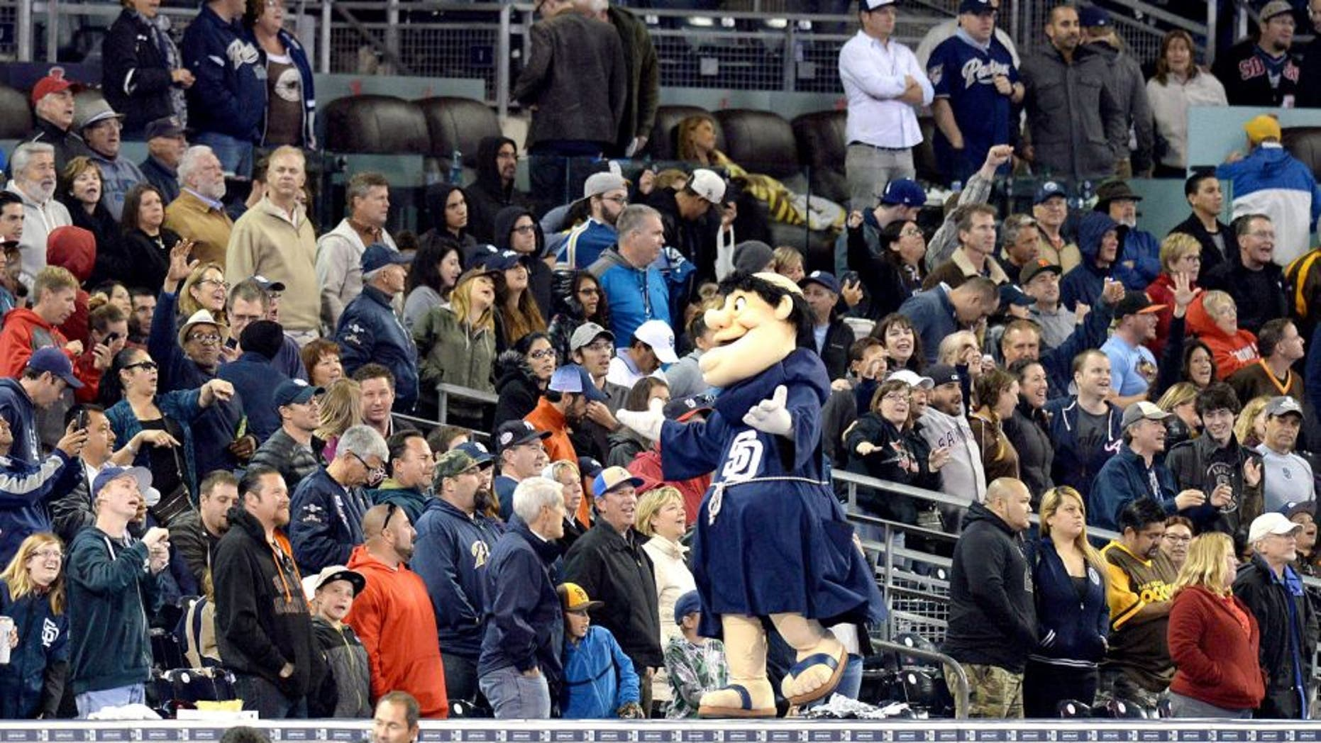 "May 15, 2015; San Diego, CA, USA; The San Diego Padres mascot The Swingin Friar leads the crowd in ""Take Me Out to the Ball Game"" during the seventh inning against the Washington Nationals at Petco Park. Mandatory Credit: Jake Roth-USA TODAY Sports"