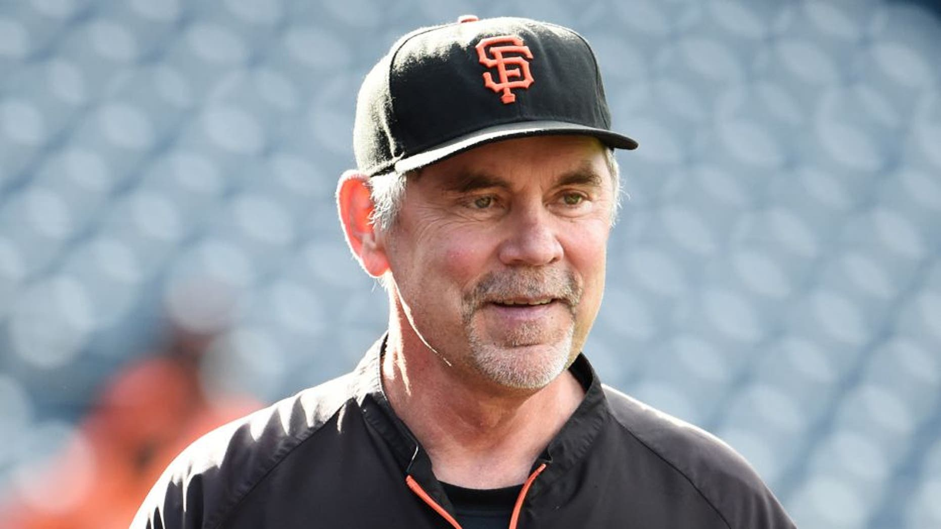 SAN DIEGO, CA - JULY 21: Bruce Bochy #15 of the San Francisco Giants looks on during batting practice before a baseball game against the San Diego Padres at Petco Park July 21, 2015 in San Diego, California. (Photo by Denis Poroy/Getty Images)
