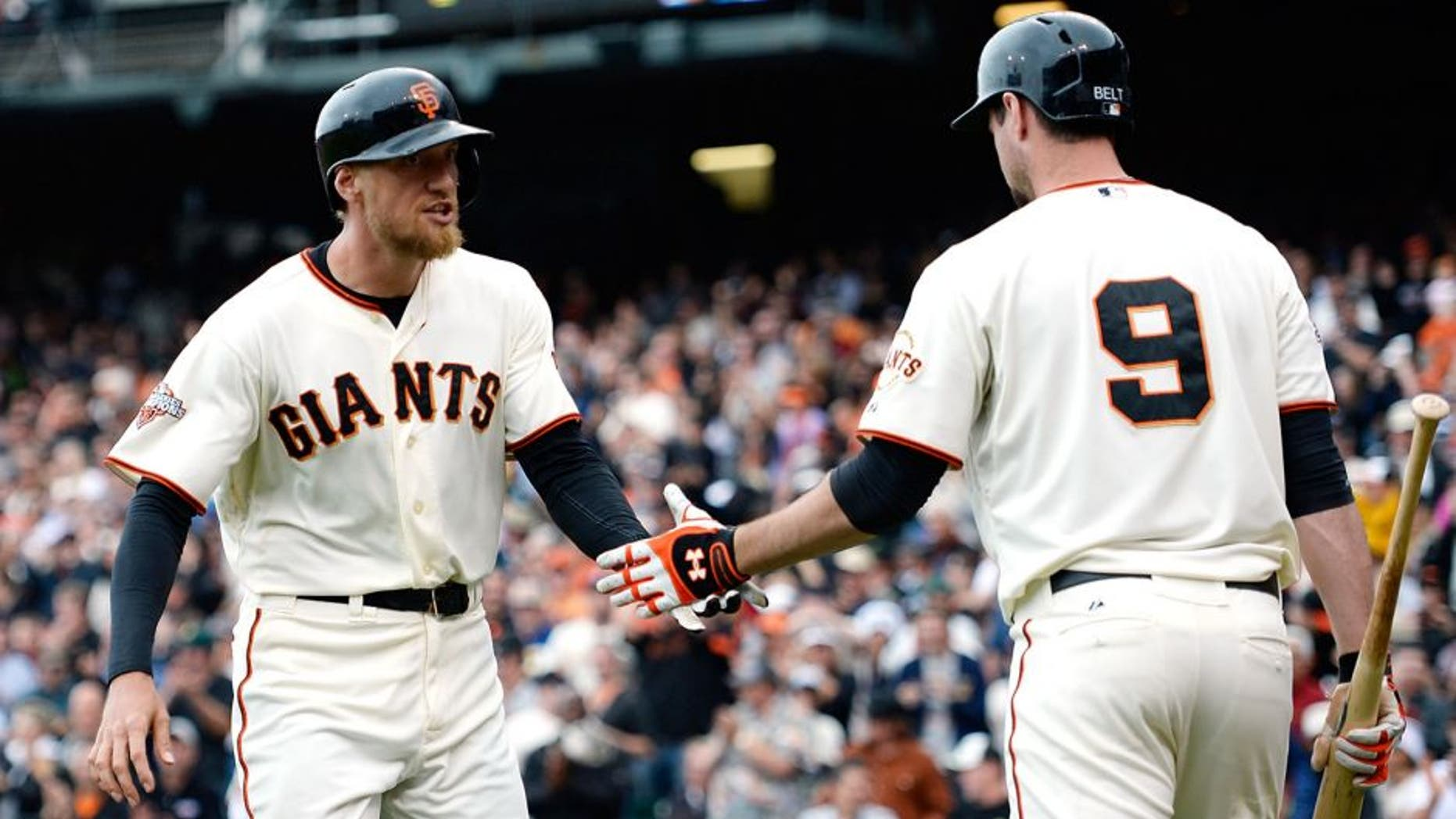 SAN FRANCISCO, CA - JUNE 23: Hunter Pence #8 of the San Francisco Giants is congratulated by Brandon Belt #9 after Pence hit a solo home run in the seventh inning against the Miami Marlins at AT&T Park on June 23, 2013 in San Francisco, California. (Photo by Thearon W. Henderson/Getty Images)