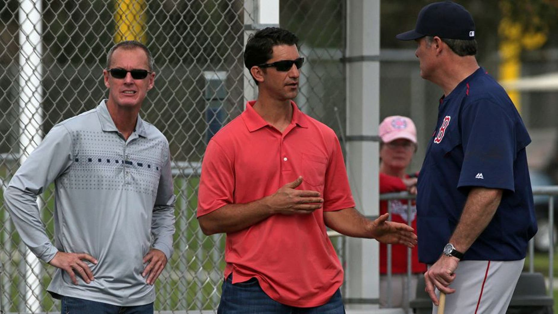FORT MYERS, FL - FEBRUARY 23: Left to right: Allard Baird, Red Sox Vice President, Player Personnel, and Red Sox assistant general manager Mike Hazen talk with Boston Red Sox manager John Farrell. It was reported today that Cuban super prospect Yoan Moncada had agreed to sign with the team for a record $31.5 million signing bonus. (Photo by Barry Chin/The Boston Globe via Getty Images)
