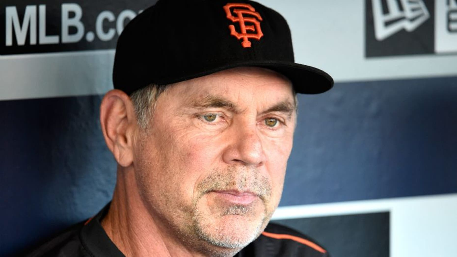 SAN DIEGO, CA - SEPTEMBER 22: Bruce Bochy #15 of the San Francisco Giants answers a question in the dugout before a baseball game against the San Diego Padres at Petco Park September 22, 2015 in San Diego, California. (Photo by Denis Poroy/Getty Images)