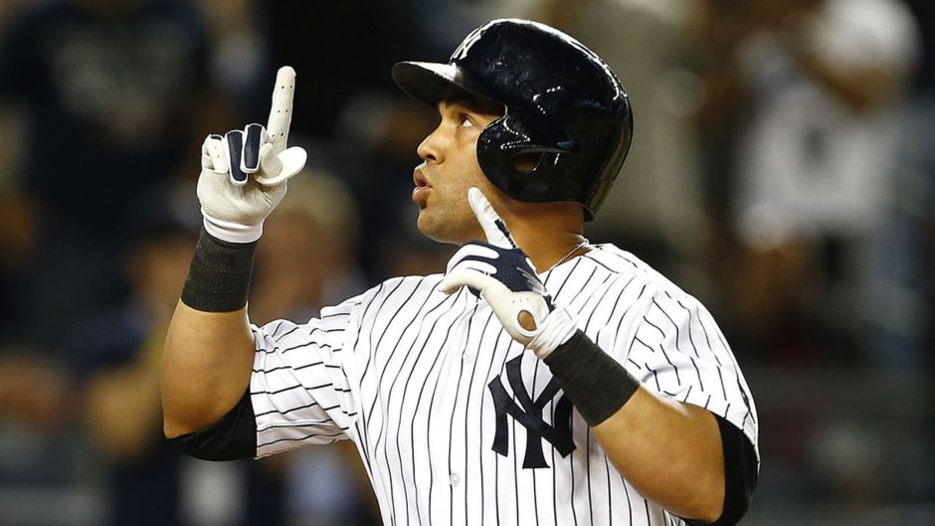 NEW YORK, NY - SEPTEMBER 24: Carlos Beltran #36 of the New York Yankees gestures after hitting a three-run home run against the Chicago White Sox during the third inning of a MLB baseball game at Yankee Stadium on September 24, 2015 in the Bronx borough of New York City. The Yankees defeated the White Sox 3-2. (Photo by Rich Schultz/Getty Images)