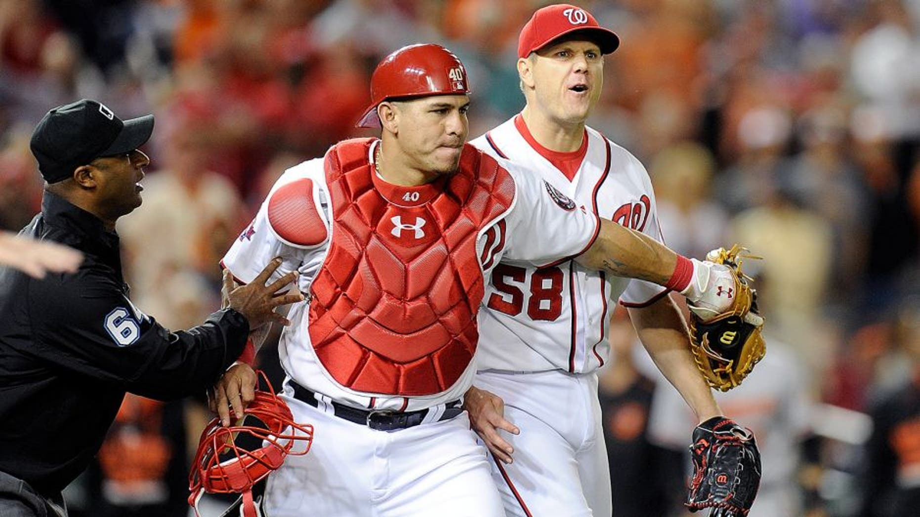 WASHINGTON, DC - SEPTEMBER 23: Jonathan Papelbon #58 of the Washington Nationals is restrained by Wilson Ramos #40 after being thrown out of the game in the ninth inning against the Baltimore Orioles at Nationals Park on September 23, 2015 in Washington, DC. (Photo by Greg Fiume/Getty Images)