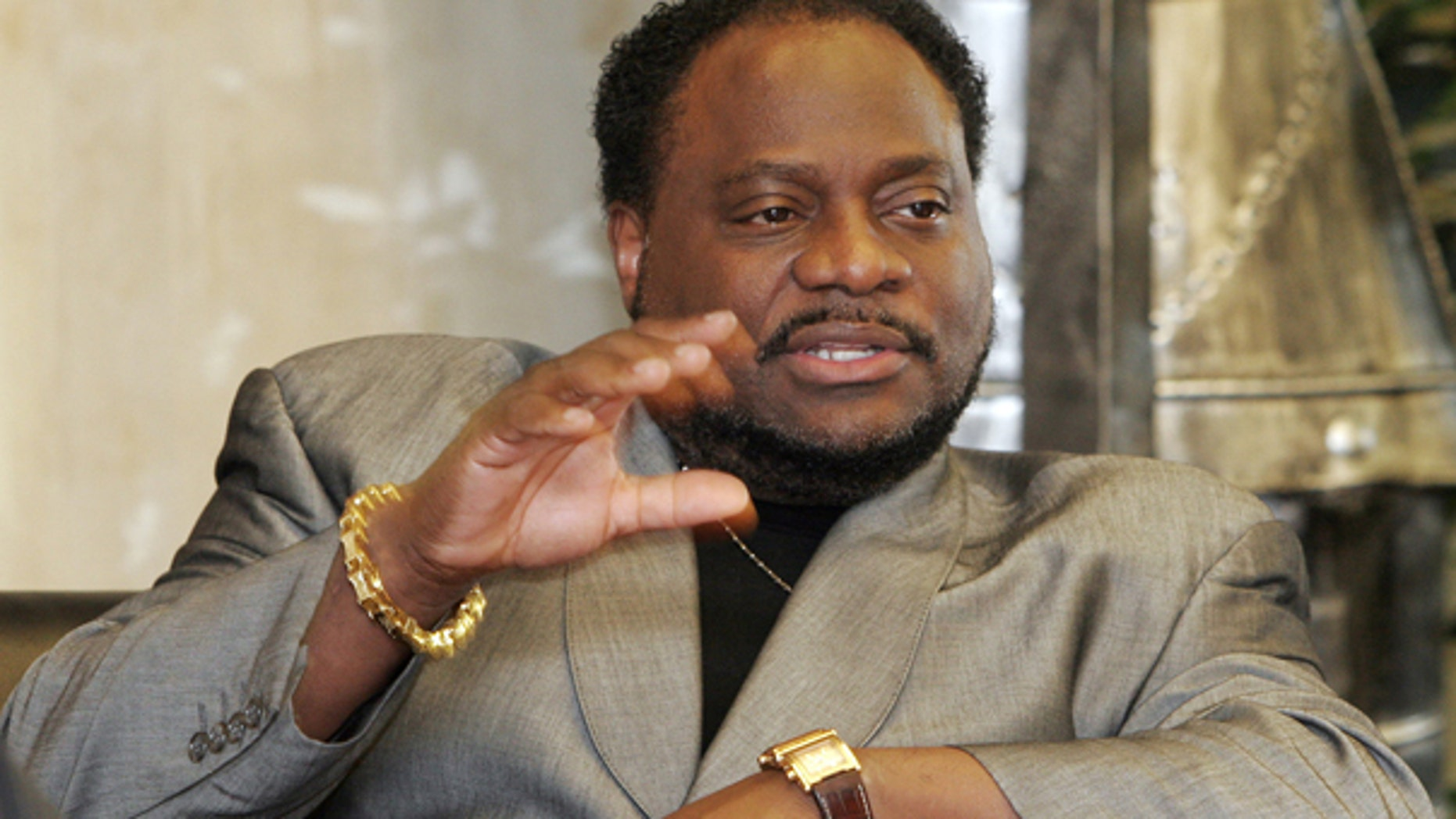 In this Jan. 18 2007 file photo, Bishop Eddie Long, of the New Birth Missionary Baptist Church, in Lithonia, Ga. gestures during an interview in Lithonia. Several men have filed a lawsuit accusing Long of exploiting his role as pastor of an Atlanta-area megachurch to coerce them into sexual relationships.