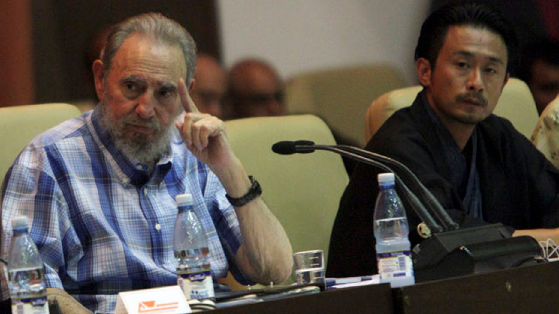Sept. 21: Cuba's former President Fidel Castro, left, attends a meeting with members of the Peace Boat organization in Havana, Cuba.