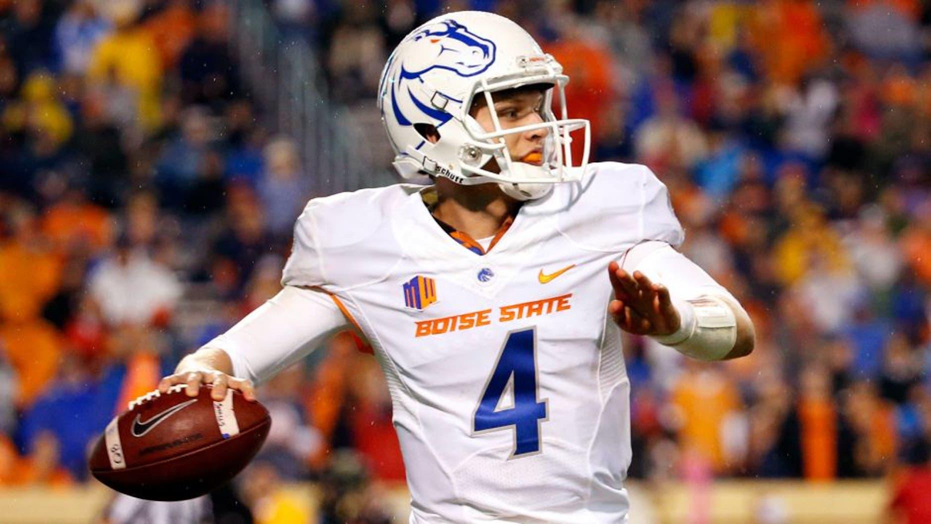 Sep 25, 2015; Charlottesville, VA, USA; Boise State Broncos quarterback Brett Rypien (4) throws the ball against the Virginia Cavaliers in the third quarter at Scott Stadium. Mandatory Credit: Amber Searls-USA TODAY Sports