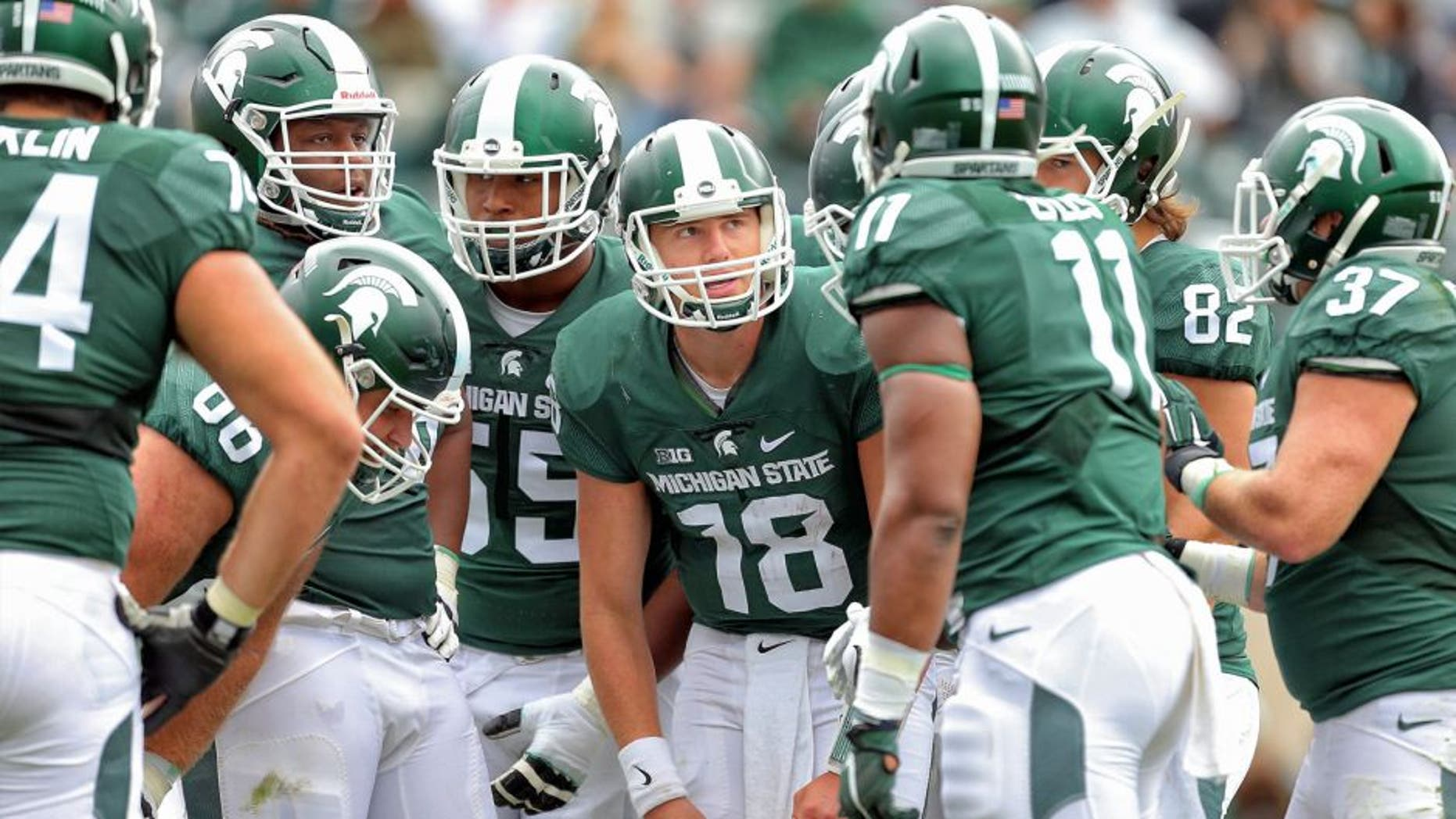 Sep 19, 2015; East Lansing, MI, USA; Michigan State Spartans quarterback Connor Cook (18) call a play in the huddle during the 2nd half of a game at Spartan Stadium. MSU won 35-21. Mandatory Credit: Mike Carter-USA TODAY Sports