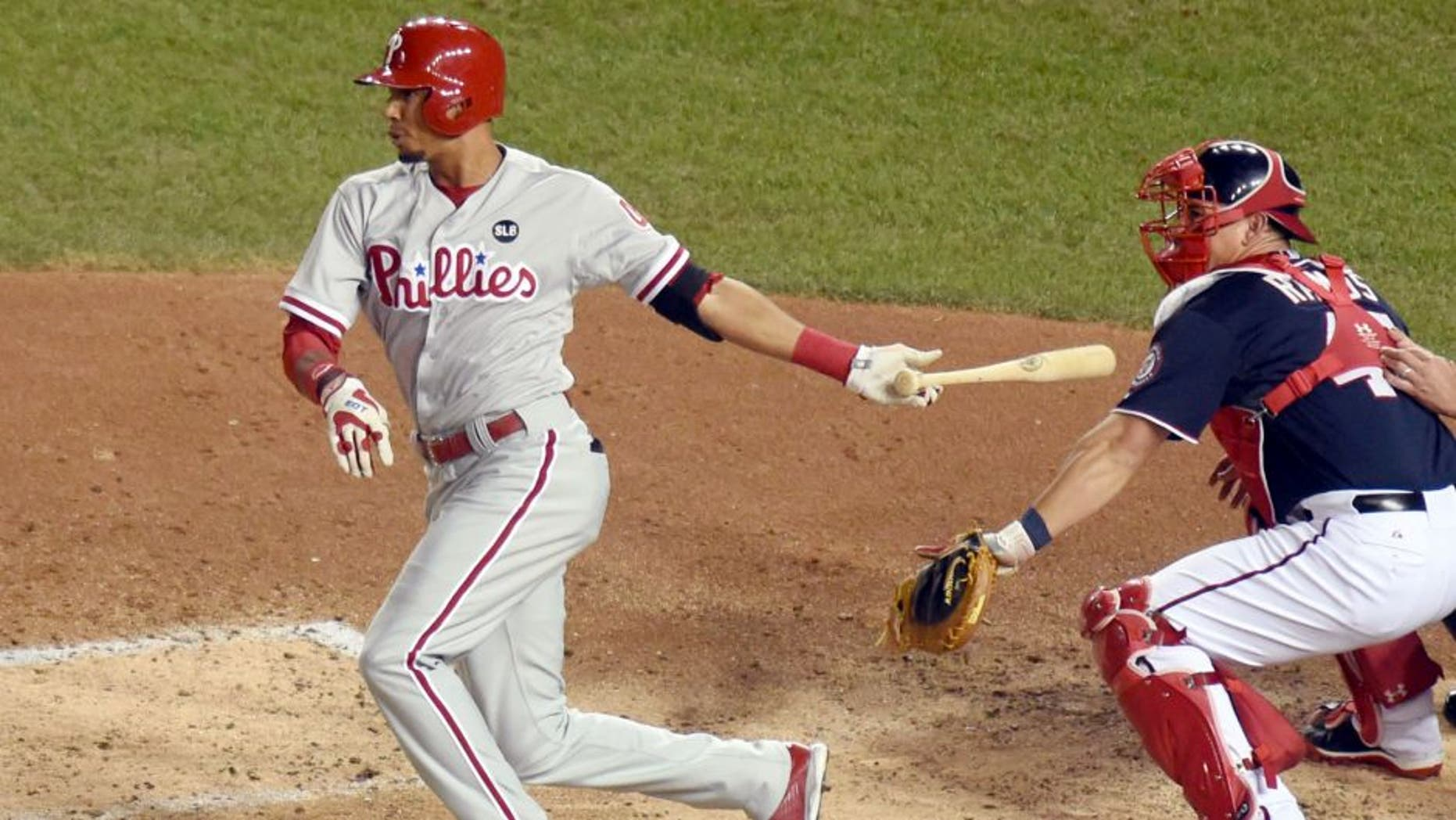 WASHINGTON, DC - SEPTEMBER 25: Aaron Altherr #40 of the Philadelphia Phillies hits a inside the park grand slam homer in the second inning during a baseball game against the Washington Nationals at Nationals Park on September 25, 2015 in Washington, DC. (Photo by Mitchell Layton/Getty Images)