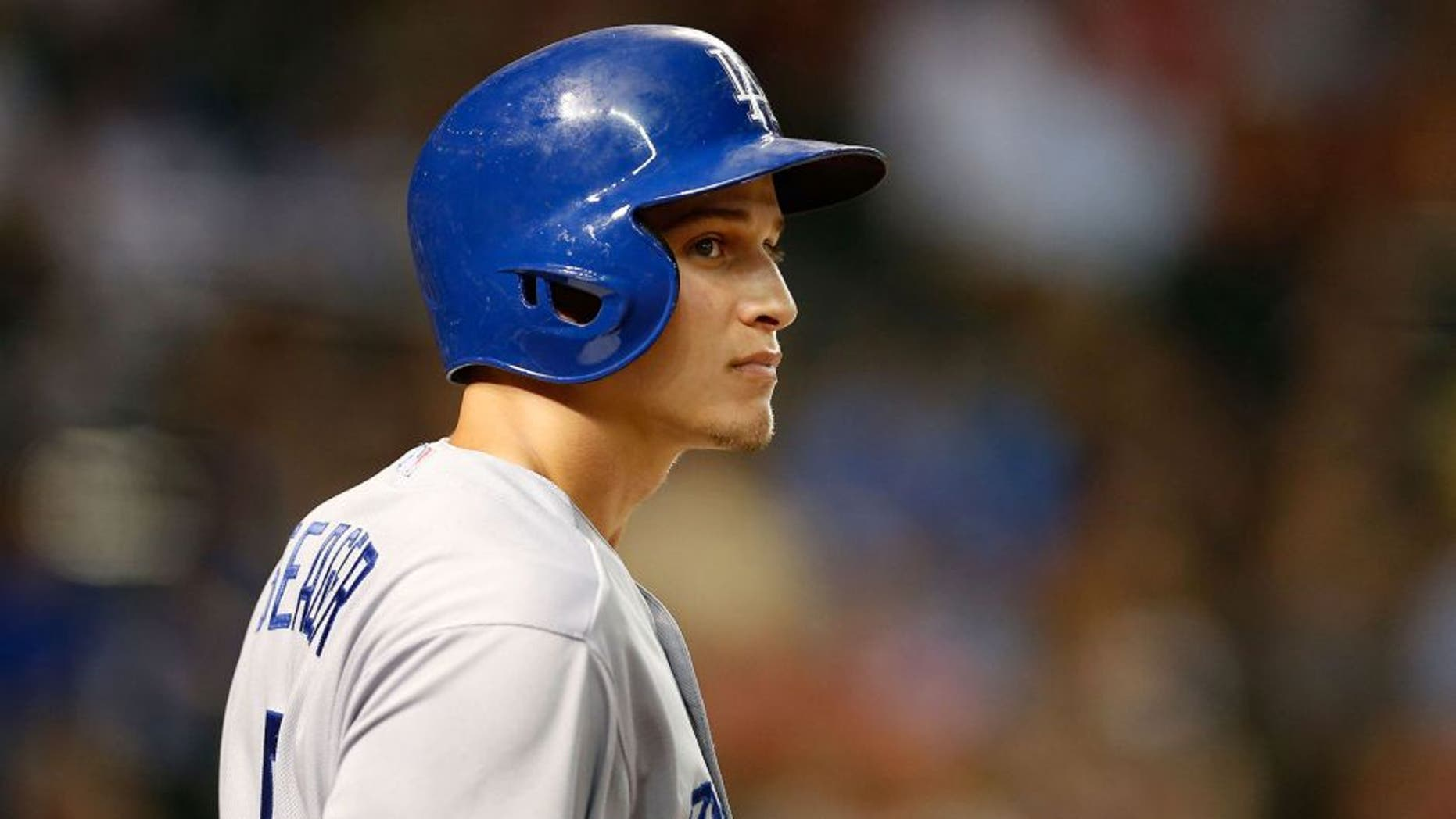 PHOENIX, AZ - SEPTEMBER 11: Corey Seager #5 of the Los Angeles Dodgers stands on deck during the MLB game against the Arizona Diamondbacks at Chase Field on September 11, 2015 in Phoenix, Arizona. The Diamondbacks defeated the Dodgers 12-4. (Photo by Christian Petersen/Getty Images)