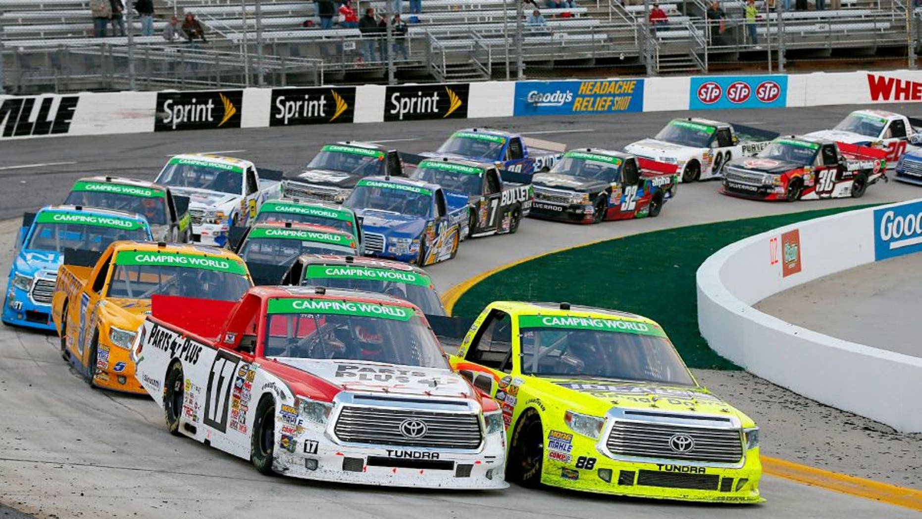 MARTINSVILLE, VA - MARCH 30: Timothy Peters, driver of the #17 Parts Plus Toyota, and Matt Crafton, driver of the #88 Ideal Doors / Menards Toyota, lead the field to a restart during the NASCAR Camping World Truck Series Kroger 250 at Martinsville Speedway on March 30, 2014 in Martinsville, Virginia. (Photo by Matt Sullivan/Getty Images)