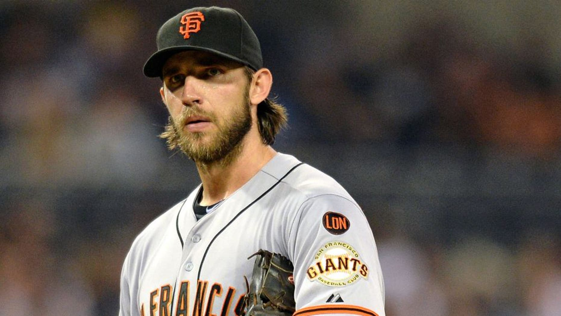 Sep 24, 2015; San Diego, CA, USA; San Francisco Giants starting pitcher Madison Bumgarner (40) looks to the San Diego Padres dugout after right fielder Matt Kemp (not pictured) yelled from the dugout at Petco Park. Mandatory Credit: Jake Roth-USA TODAY Sports
