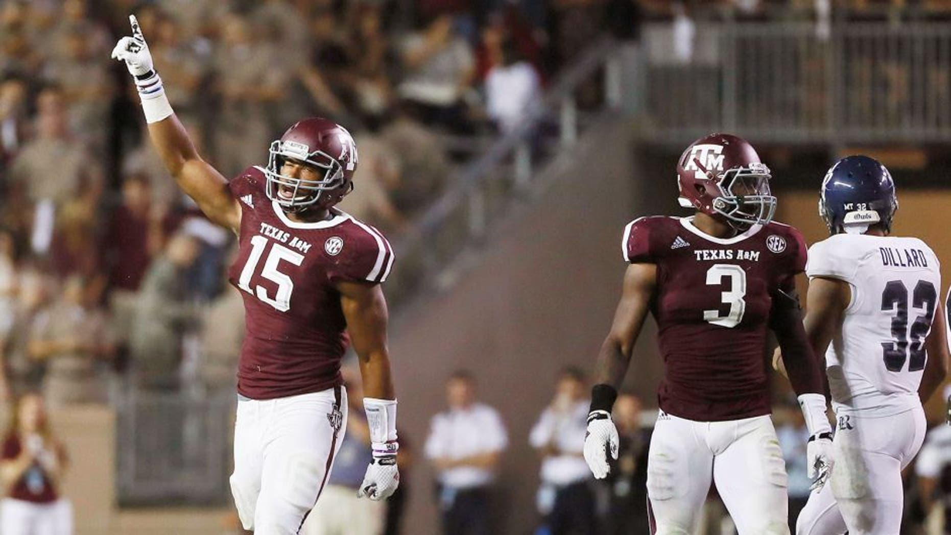 Sep 13, 2014; College Station, TX, USA; Texas A&M Aggies defensive lineman Myles Garrett (15) reacts against the Rice Owls during the second half at Kyle Field. Mandatory Credit: Soobum Im-USA TODAY Sports