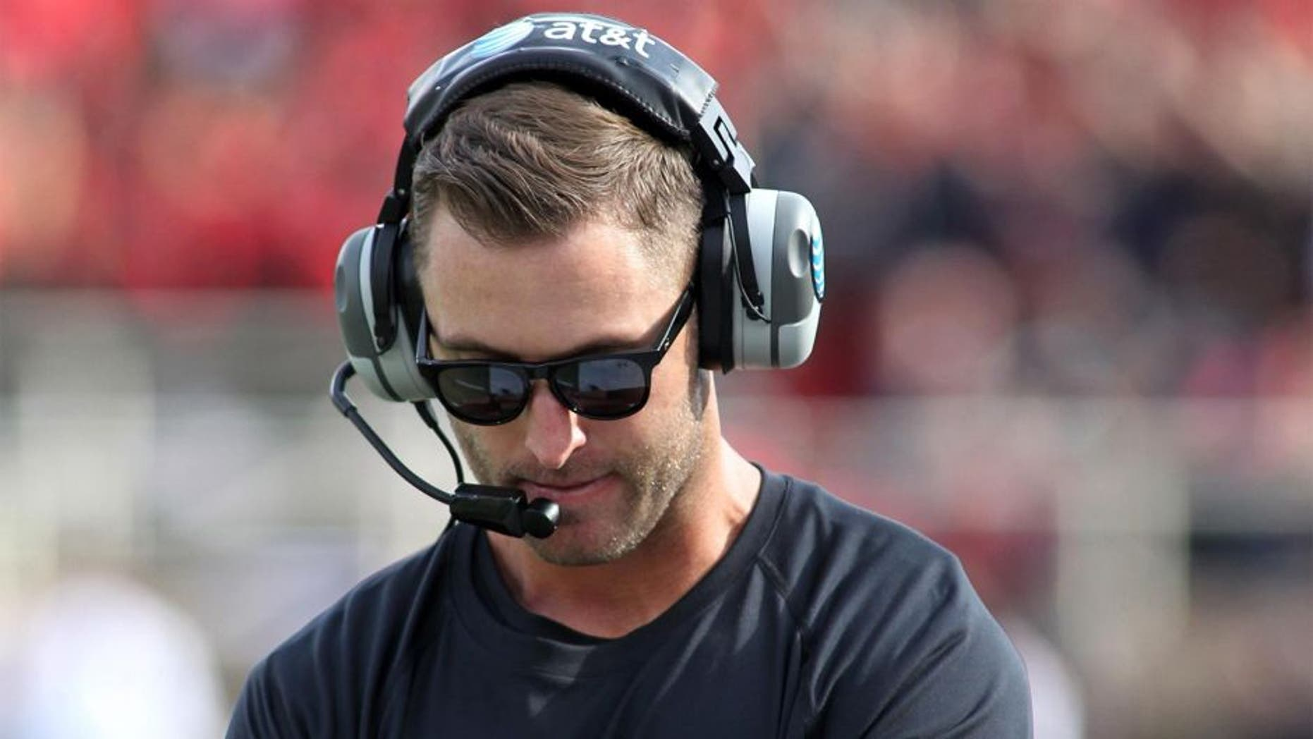 Sep 13, 2014; Lubbock, TX, USA; Texas Tech Red Raiders head coach Kliff Kingsbury looks on from the sidelines during the fourth quarter in the game with the Arkansas Razorbacks at Jones AT&T Stadium. Mandatory Credit: Michael C. Johnson-USA TODAY Sports