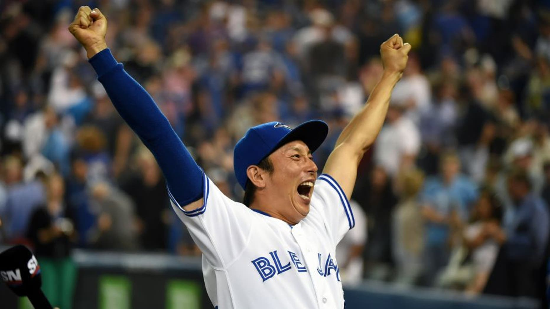 Sep 2, 2015; Toronto, Ontario, CAN; Toronto Blue Jays infielder Munenori Kawasaki (66) reacts to fans cheers during post-game celebrations afterthe Jays defeated Cleveland Indians 5-1 at Rogers Centre. Mandatory Credit: Dan Hamilton-USA TODAY Sports
