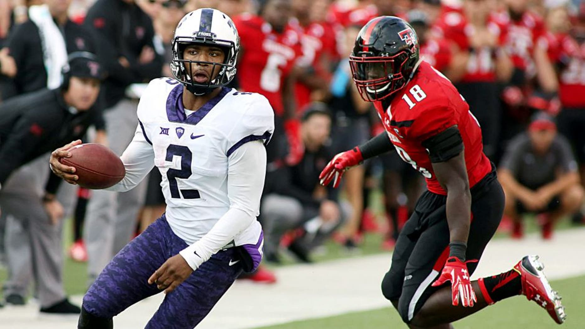 Sep 26, 2015; Lubbock, TX, USA; Texas Christian University Horned Frogs quarterback Trevone Boykin (2) looks for running room against the Texas Tech Red Raiders in the second half at Jones AT&T Stadium. TCU defeated Texas Tech 55-52. Mandatory Credit: Michael C. Johnson-USA TODAY Sports