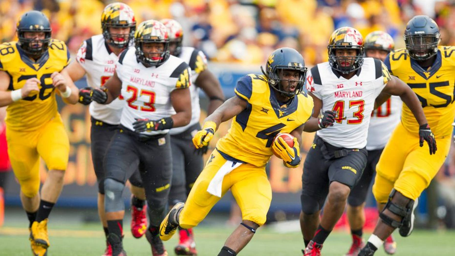 Sep 26, 2015; Morgantown, WV, USA; West Virginia Mountaineers running back Wendell Smallwood runs the ball against the Maryland Terrapins during the first quarter at Milan Puskar Stadium. Mandatory Credit: Ben Queen-USA TODAY Sports
