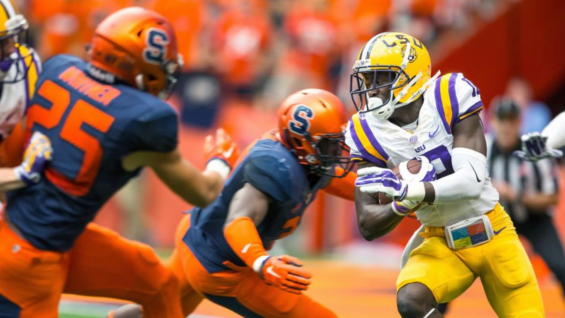 SYRACUSE, NY - SEPTEMBER 26: Tre'Davious White #18 of the LSU Tigers carries the ball during the first quarter against the Syracuse Orange on September 26, 2015 at The Carrier Dome in Syracuse, New York. (Photo by Brett Carlsen/Getty Images)
