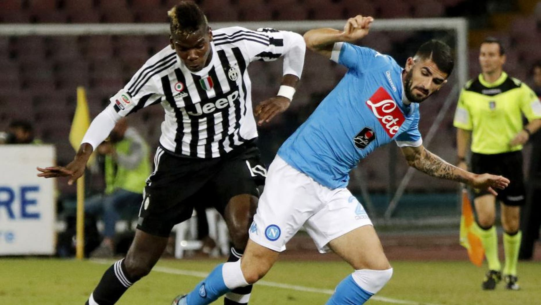 Juventus' French midfielder Paul Pogba (L) vies with Napoli's Albanian defender Elseid Hysaj during the Italian Serie A football match SSC Napoli vs FC Juventus on September 26, 2015 at the San Paolo stadium in Naples. AFP PHOTO / CARLO HERMANN (Photo credit should read CARLO HERMANN/AFP/Getty Images)
