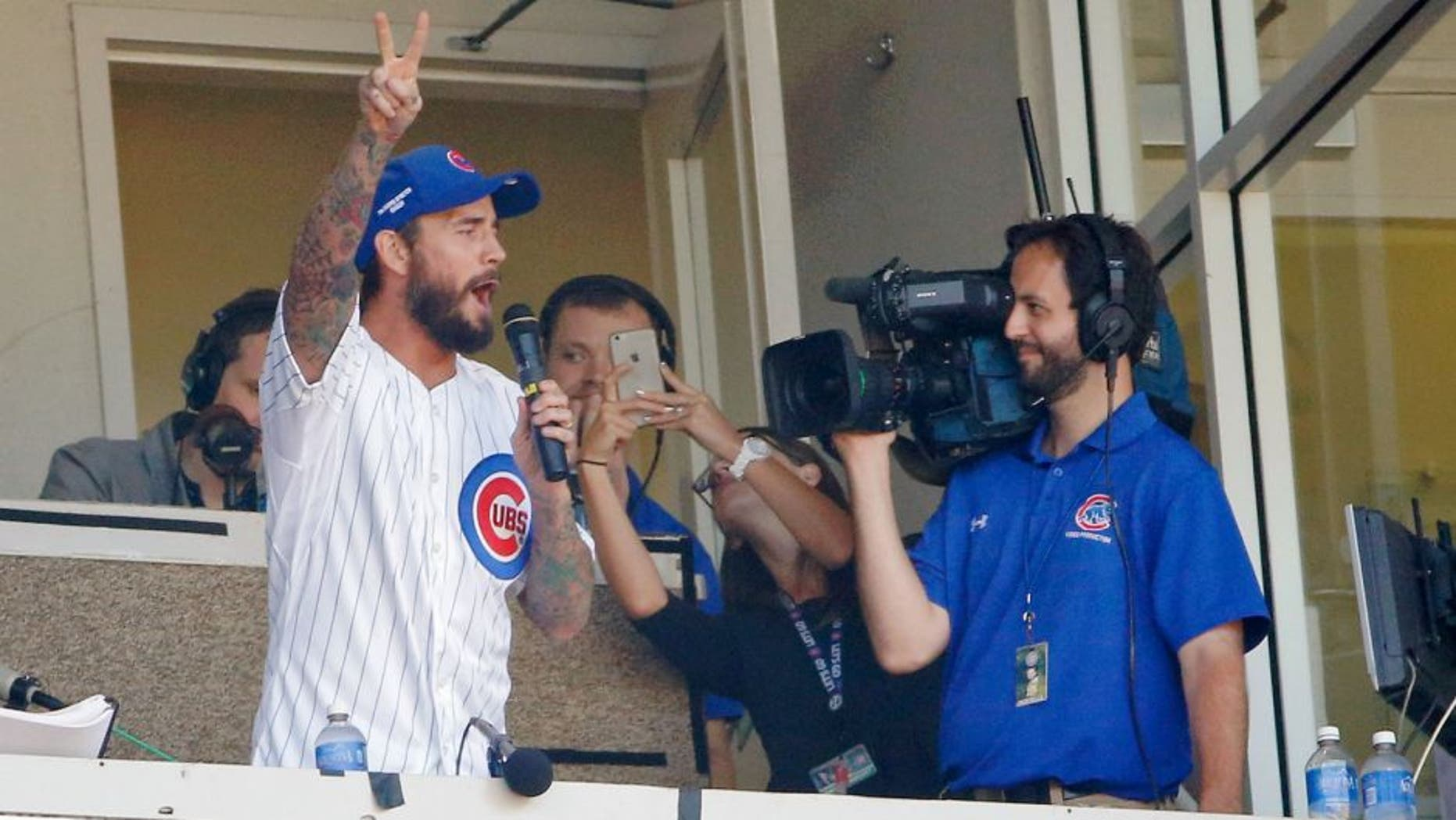 CHICAGO, IL - SEPTEMBER 26: UFC fighter CM Punk sings the seventh inning stretch during the game between the Chicago Cubs and the Pittsburgh Pirates at Wrigley Field on September 26, 2015 in Chicago, Illinois. (Photo by Jon Durr/Getty Images)