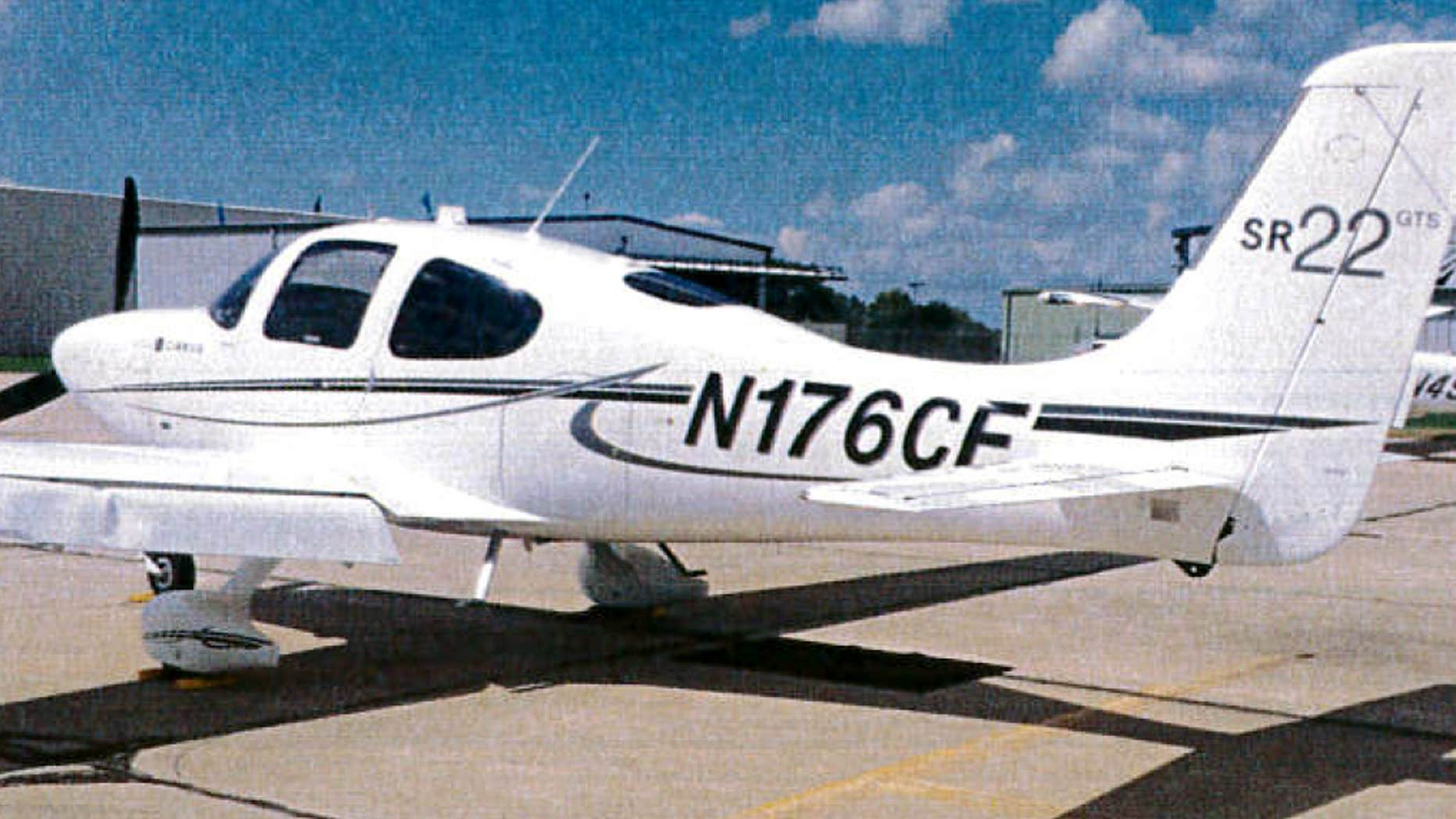 This undated photo provided by the Bloomington Normal Airport Authority shows a damaged wing of a Cirrus SR22 single engine plane at the Central Illinois Regional Airport in Bloomington, Ill.