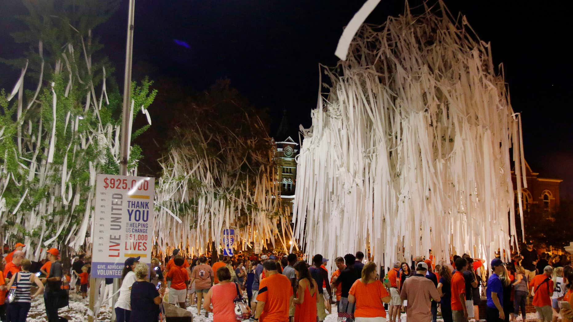 Fans celebrate at Toomer's Corner after Auburn defeated LSU 18-13 in an NCAA college football game Saturday, Sept. 24, 2016, in Auburn, Ala.
