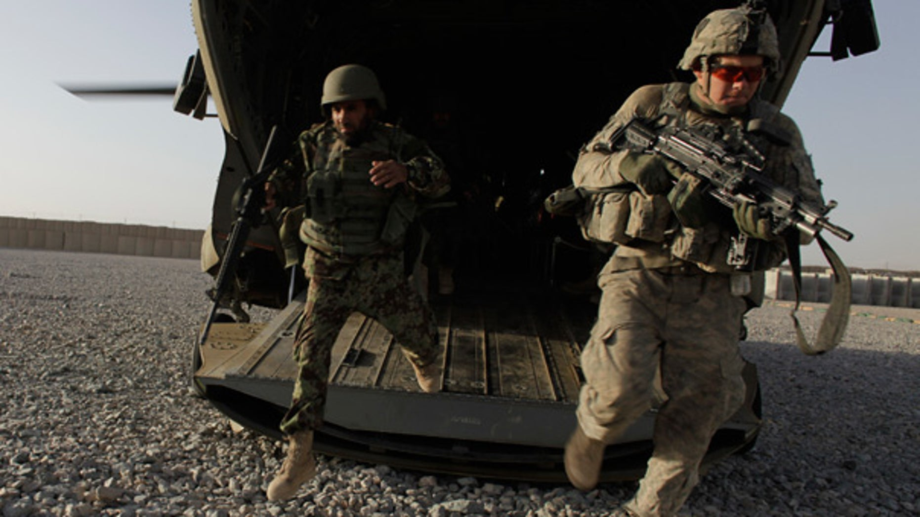Sept. 11: U.S. soldiers deploy off the back of an army helicopter in Zhari District, southern Afghanistan.