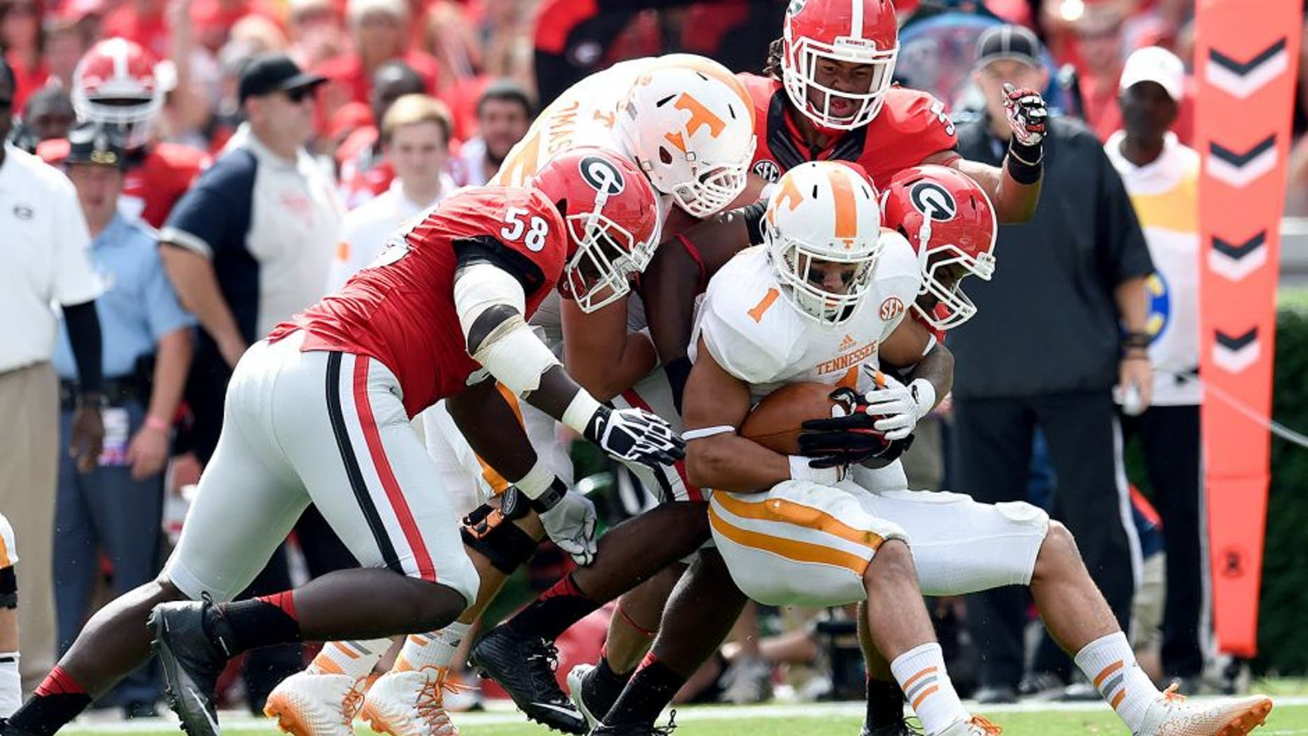 Sep 27, 2014; Athens, GA, USA; Tennessee Volunteers running back Jalen Hurd (1) is tackled by Georgia Bulldogs defensive end Sterling Bailey (58) linebacker Ramik Wilson (51) and linebacker Jordan Jenkins (59) during the first quarter at Sanford Stadium. Mandatory Credit: Dale Zanine-USA TODAY Sports