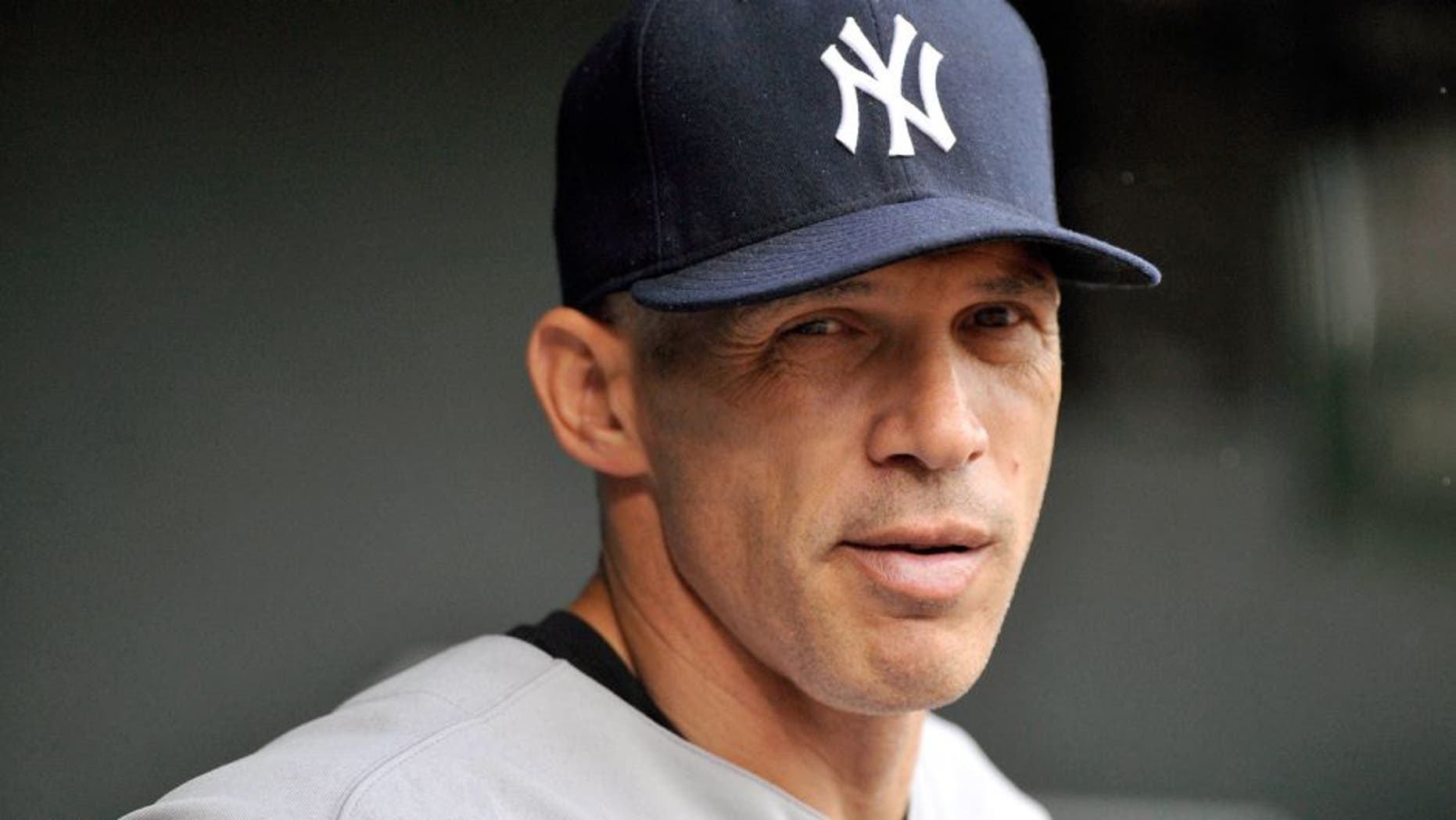 Sep 13, 2014; Baltimore, MD, USA; New York Yankees manager Joe Girardi (28) during a game against the Baltimore Orioles at Oriole Park at Camden Yards. Mandatory Credit: Joy R. Absalon-USA TODAY Sports
