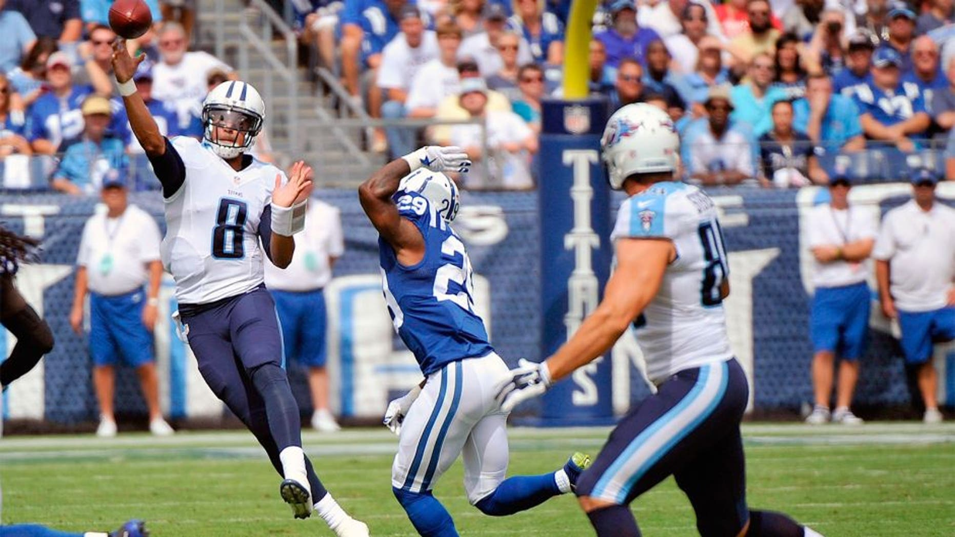 NASHVILLE, TN - SEPTEMBER 27: Quarterback Marcus Mariota #8 of the Tennessee Titans drops back to throw a pass to Craig Stevens #88 against the Indianapolis Colts at Nissan Stadium on September 27, 2015 in Nashville, Tennessee. (Photo by Frederick Breedon/Getty Images)