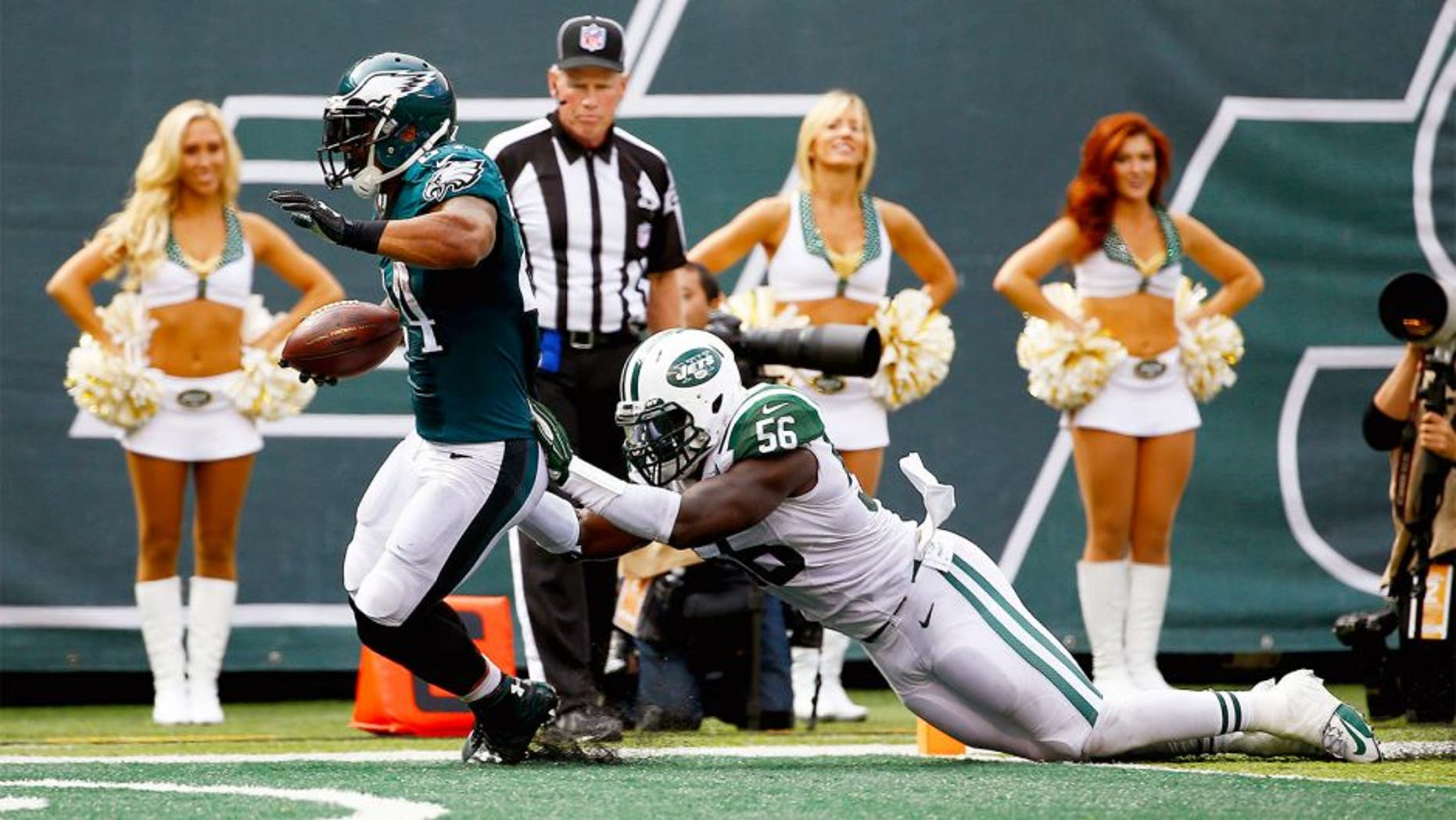 EAST RUTHERFORD, NJ - SEPTEMBER 27: Ryan Mathews #24 of the Philadelphia Eagles scores a touchdown in the second quarter as Demario Davis #56 of the New York Jets defends at MetLife Stadium on September 27, 2015 in East Rutherford, New Jersey. (Photo by Al Bello/Getty Images)