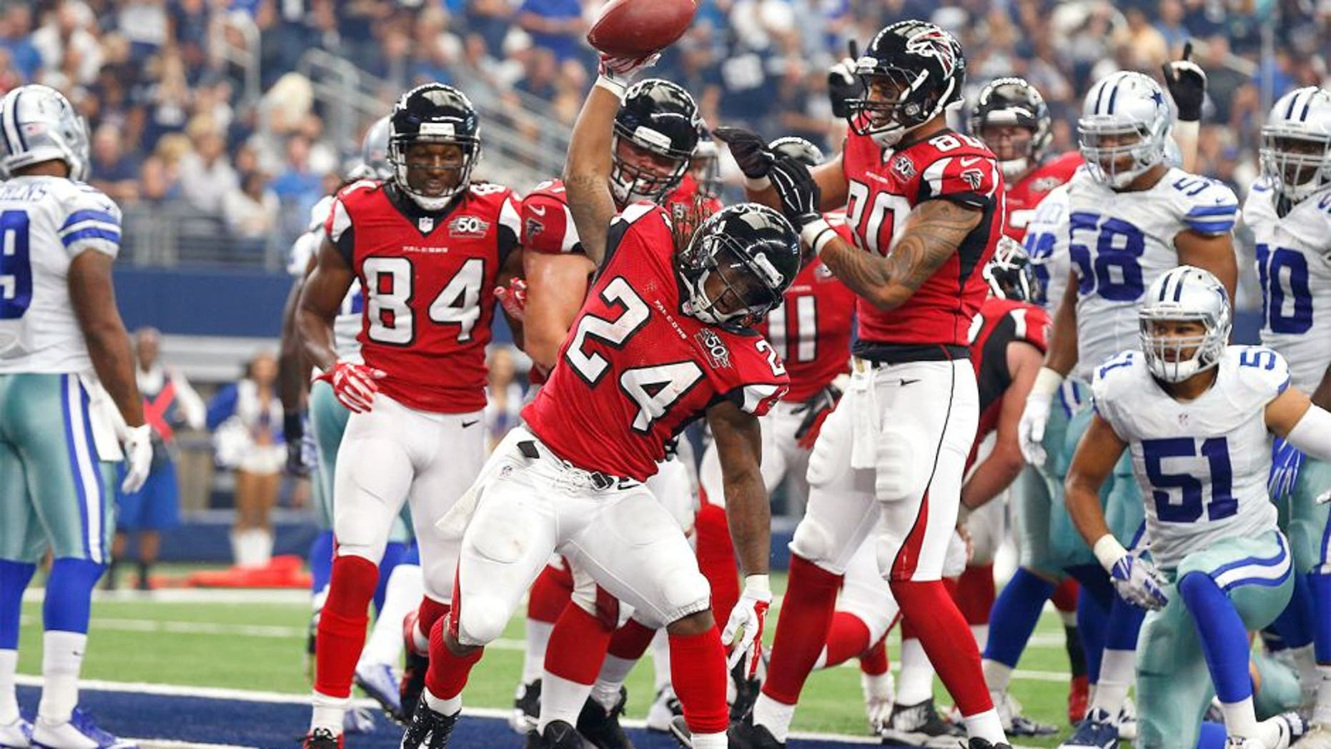 Sep 27, 2015; Arlington, TX, USA; Atlanta Falcons running back Devonta Freeman (24) spikes the ball after scoring a touchdown in the second quarter against the Dallas Cowboys at AT&T Stadium. Mandatory Credit: Matthew Emmons-USA TODAY Sports