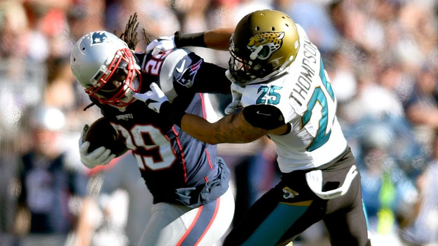 Sep 27, 2015; Foxborough, MA, USA; New England Patriots running back LeGarrette Blount (29) carries the ball as Jacksonville Jaguars defensive back Peyton Thompson (25) defends in the third quarter at Gillette Stadium. New England defeated Jacksonville 51-17. Mandatory Credit: James Lang-USA TODAY Sports