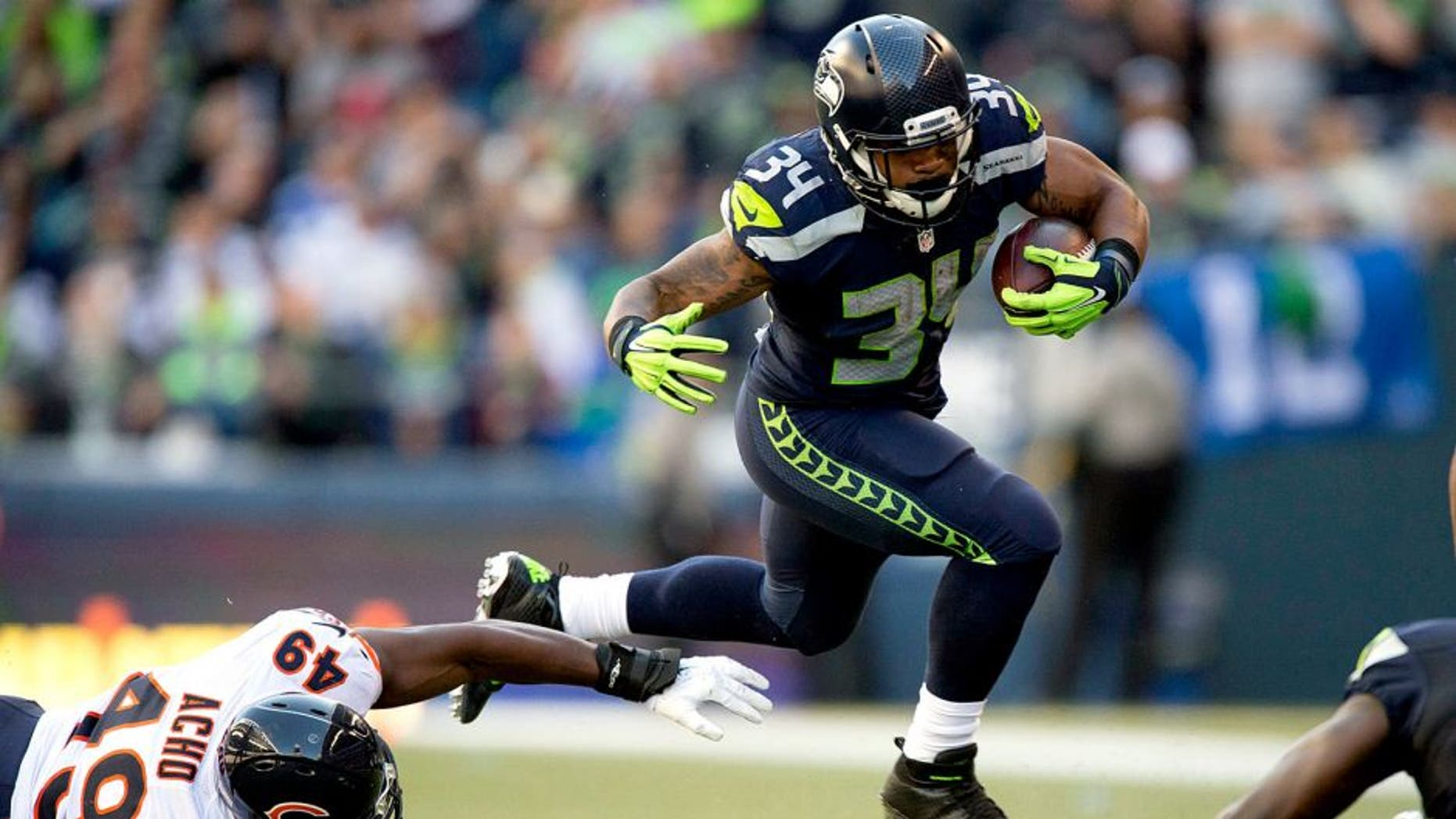 Sep 27, 2015; Seattle, WA, USA; Seattle Seahawks running back Thomas Rawls (34) breaks away from Chicago Bears linebacker Sam Acho (49) during the third quarter at CenturyLink Field. The Seahawks won 26-0. Mandatory Credit: Troy Wayrynen-USA TODAY Sports