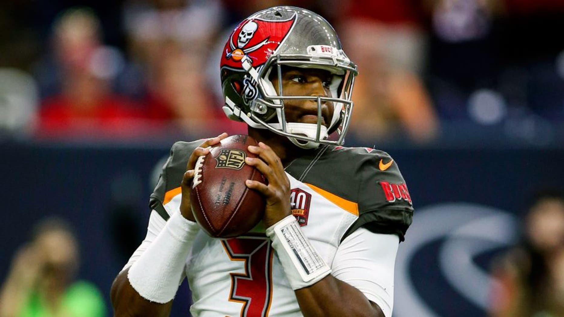 Sep 27, 2015; Houston, TX, USA; Tampa Bay Buccaneers quarterback Jameis Winston (3) looks for an open receiver during the first quarter against the Houston Texans at NRG Stadium. Mandatory Credit: Troy Taormina-USA TODAY Sports