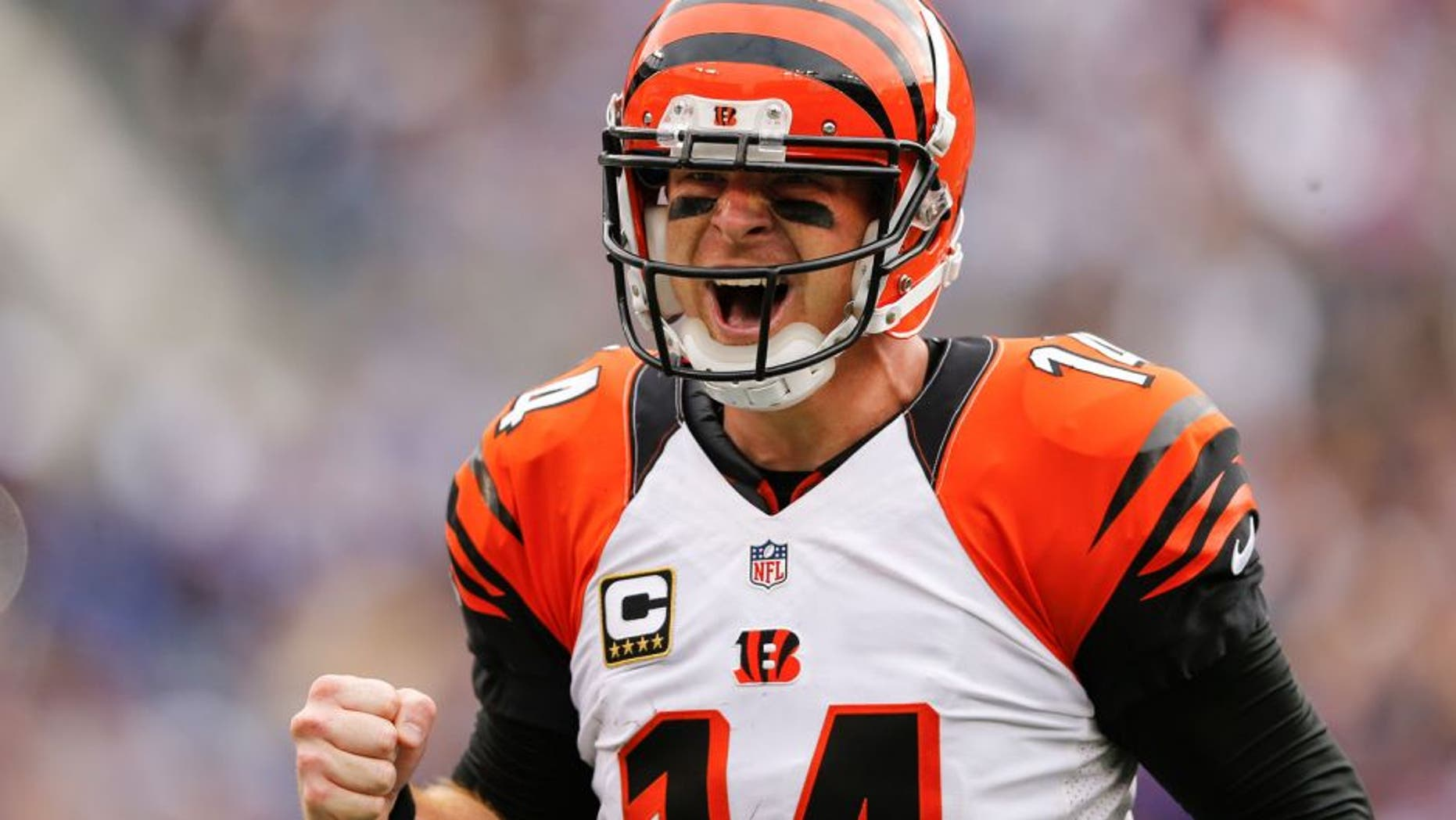 Cincinnati Bengals quarterback Andy Dalton (14) celebrates wide receiver A.J. Green's touchdown during the second half of an NFL football game against the Baltimore Ravens in Baltimore, Sunday, Sept. 27, 2015. The Bengals defeated the Ravens 28-24. (AP Photo/Patrick Semansky)