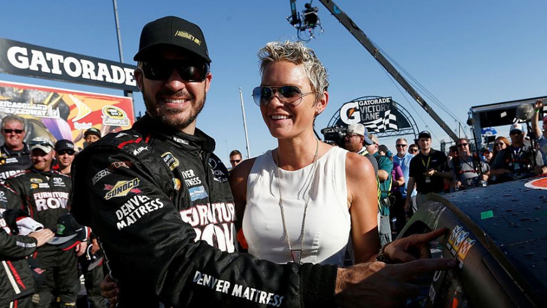 JOLIET, IL - SEPTEMBER 18: Martin Truex Jr, driver of the #78 Furniture Row/Denver Mattress Toyota, and his wife Sherry Pollex celebrate in Victory Lane during the NASCAR Sprint Cup Series Teenage Mutant Ninja Turtles 400 at Chicagoland Speedway on September 18, 2016 in Joliet, Illinois. (Photo by Jeff Zelevansky/NASCAR via Getty Images)
