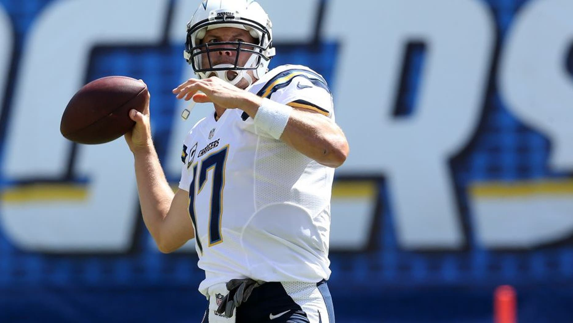 SAN DIEGO, CA - SEPTEMBER 28: Philip Rivers #17 of the San Diego Chargers throws the ball during warmups for the game with the Jacksonville Jaguars at Qualcomm Stadium on September 28, 2014 in San Diego, California. (Photo by Stephen Dunn/Getty Images)