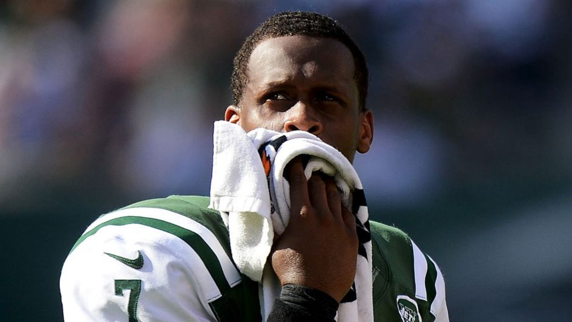 EAST RUTHERFORD, NJ - SEPTEMBER 28: Geno Smith #7 of the New York Jets looks on from the bench in the fourth quarter of their 24 to 17 loss to the Detroit Lions at MetLife Stadium on September 28, 2014 in East Rutherford, New Jersey. (Photo by Ron Antonelli/Getty Images)