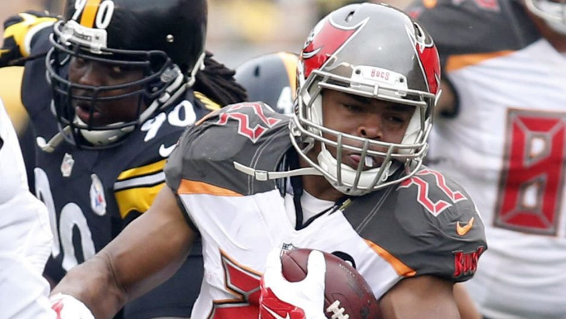 Sep 28, 2014; Pittsburgh, PA, USA; Tampa Bay Buccaneers running back Doug Martin (22) rushes the ball against the Pittsburgh Steelers during the first quarter at Heinz Field. Mandatory Credit: Charles LeClaire-USA TODAY Sports