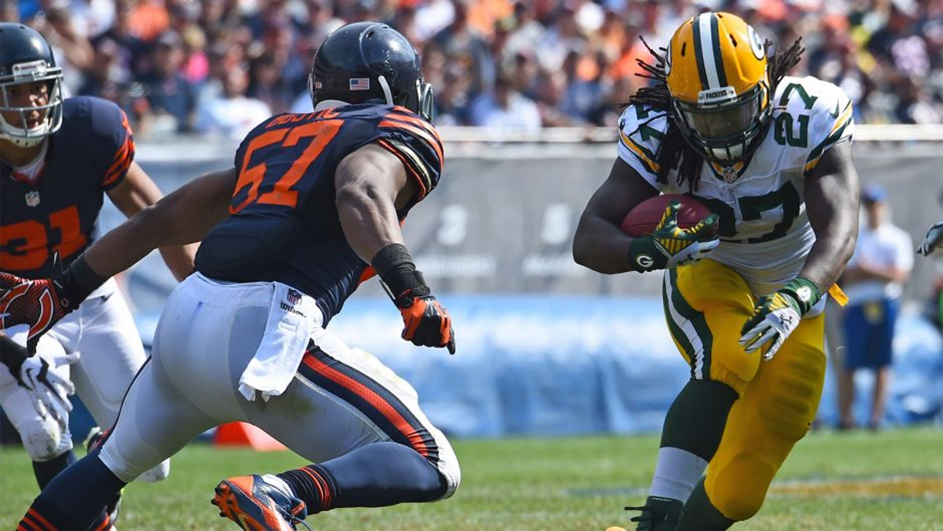 Sep 28, 2014; Chicago, IL, USA; Green Bay Packers running back Eddie Lacy (27) rushes the ball against Chicago Bears inside linebacker Jon Bostic (57) during the second half at Soldier Field. The Green Bay Packers defeats the Chicago Bears 38-17. Mandatory Credit: Mike DiNovo-USA TODAY Sports