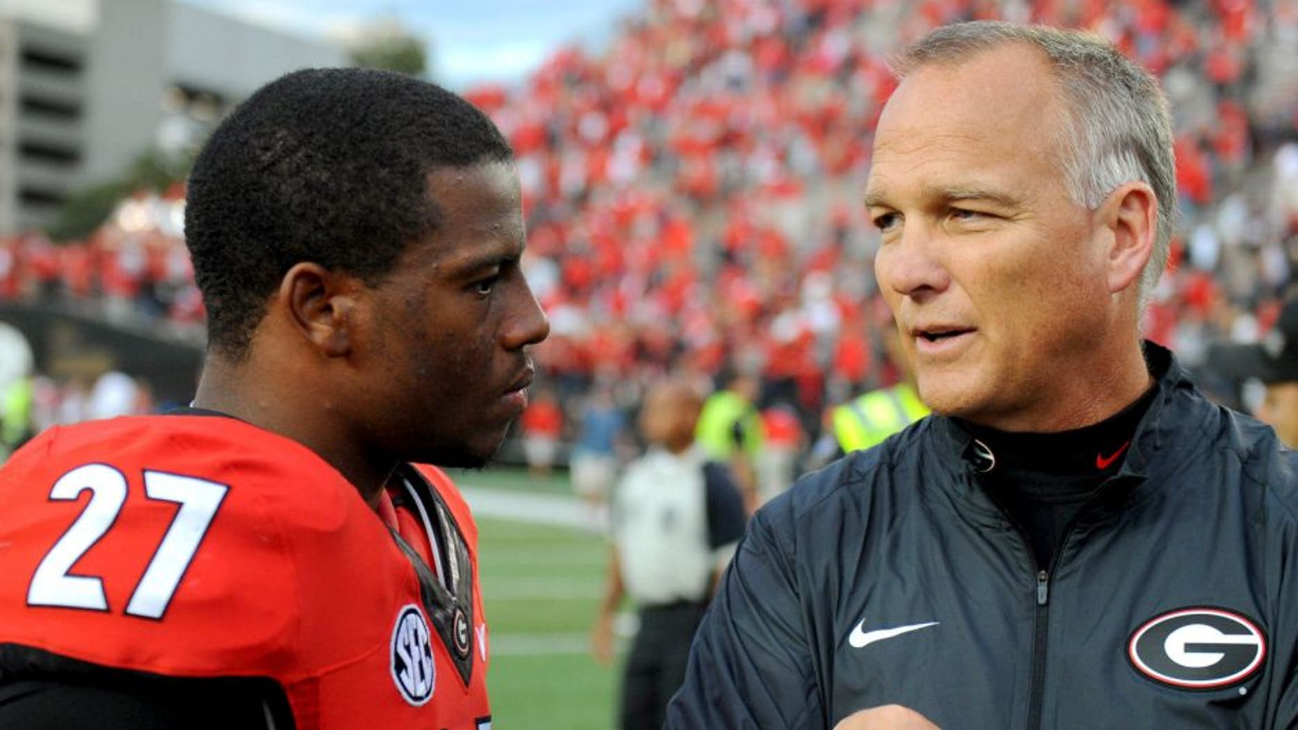 Sep 12, 2015; Nashville, TN, USA; Georgia Bulldogs running back Nick Chubb (27) talks with Georgia Bulldogs head coach Mark Richt after a win against the Vanderbilt Commodores at Vanderbilt Stadium. Georgia won 31-14. Mandatory Credit: Christopher Hanewinckel-USA TODAY Sports