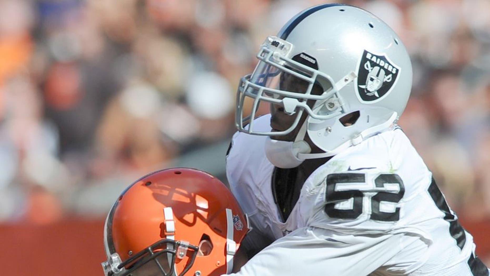 Sep 27, 2015; Cleveland, OH, USA; Oakland Raiders defensive end Khalil Mack (52) sacks Cleveland Browns quarterback Josh McCown (13) during the second half at FirstEnergy Stadium. The Raiders won 27-20. Mandatory Credit: Ken Blaze-USA TODAY Sports