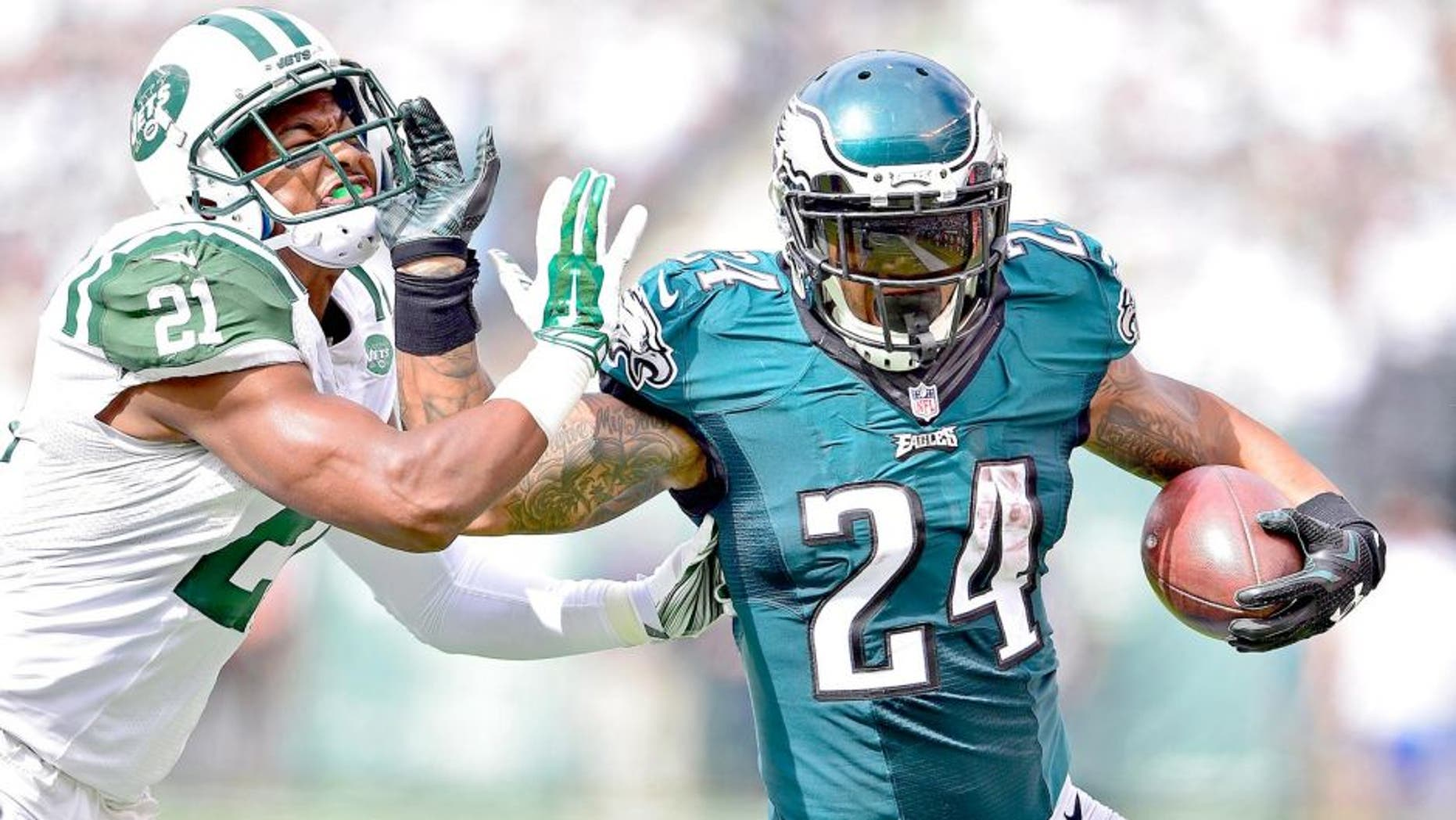 Sep 27, 2015; East Rutherford, NJ, USA; Philadelphia Eagles running back Ryan Mathews (24) stiff arms New York Jets strong safety Marcus Gilchrist (21) to gain extra yards at MetLife Stadium. Mandatory Credit: Steven Ryan-USA TODAY Sports
