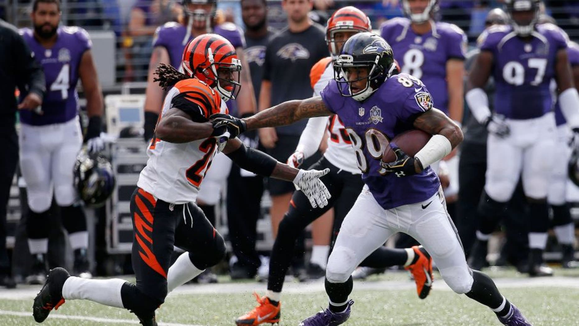 BALTIMORE, MD - SEPTEMBER 27: Wide receiver Steve Smith #89 of the Baltimore Ravens carries the ball while cornerback Adam Jones #24 of the Cincinnati Bengals defends in the third quarter of a game at M&T Bank Stadium on September 27, 2015 in Baltimore, Maryland. (Photo by Rob Carr/Getty Images)
