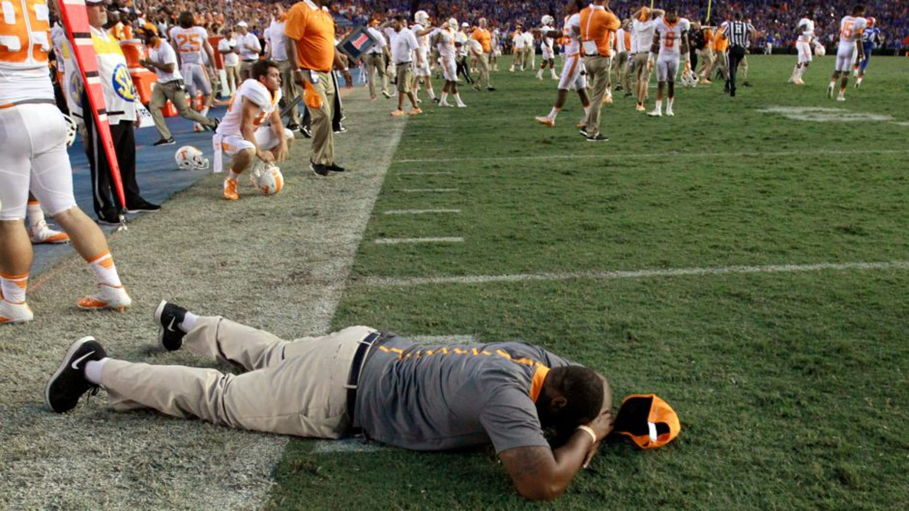 Sep 26, 2015; Gainesville, FL, USA; Tennessee Volunteers coach and players react as they lost to the Florida Gators at Ben Hill Griffin Stadium. Florida Gators defeated the Tennessee Volunteers 28-27. Mandatory Credit: Kim Klement-USA TODAY Sports