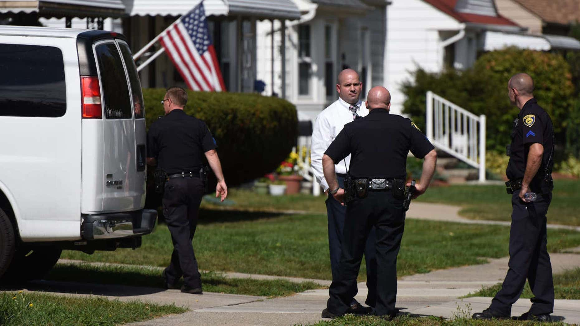 Police investigate at a home where two children were shot in Dearborn, Mich., Wednesday, Sept. 27, 2017.